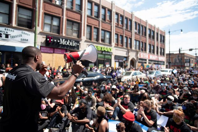 "Jahmal Cole, founder of My Block, My Hood, My City, speaks Sunday, June 7, 2020, during a peace march and food give-away organized by his nonprofit group in Chicago. ""I want to make sure we"