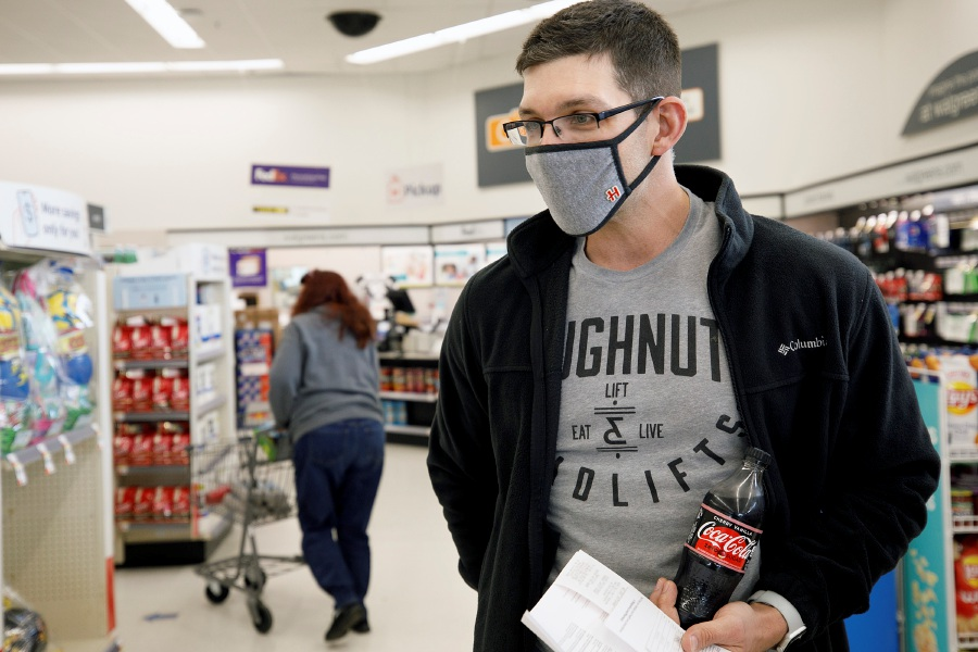 Collin Hager, of Middletown, talks about receiving the Pfizer BioNTech vaccine Thursday  at Walgreens on East Main Street in Meriden. Hager called the Walgreens vaccine hotline early Thursday and was offered the afternoon appointment. Dave Zajac, Record-Journal