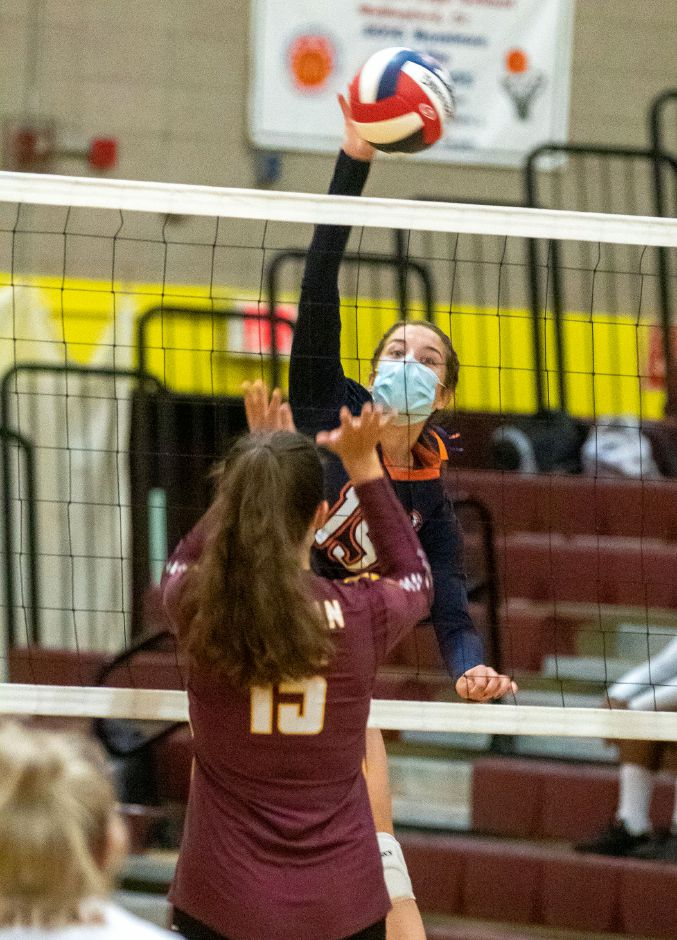 Lyman Hall's Macenzie Regan spikes the ball past Sheehan's Colleen Kelley at Sheehan High School on Friday, October 2, 2020. Aaron Flaum, Record-Journal