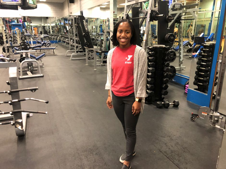 Wallingford YMCA members service associate Nadia Wilson, gives a tour of the West Side gym.| Kristen Dearborn, special to the Record-Journal