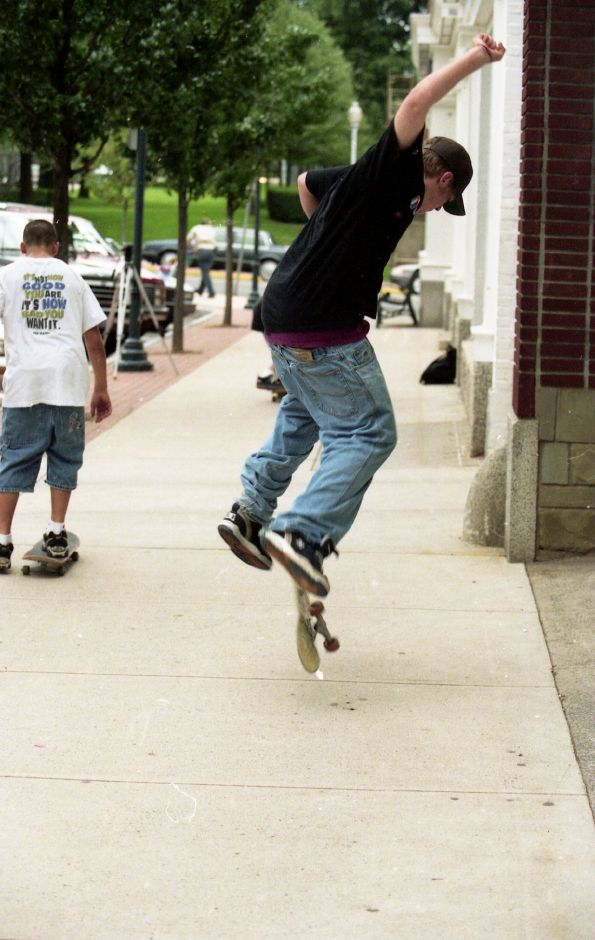 About 15 teens skated, skateboarded and bicycled around downtown in an informal protest of being banned from skateboarding or skating in the downtown area under the provisions of a measure passed by the Town Council Sept. 24, 1996. File photos, Record-Journal