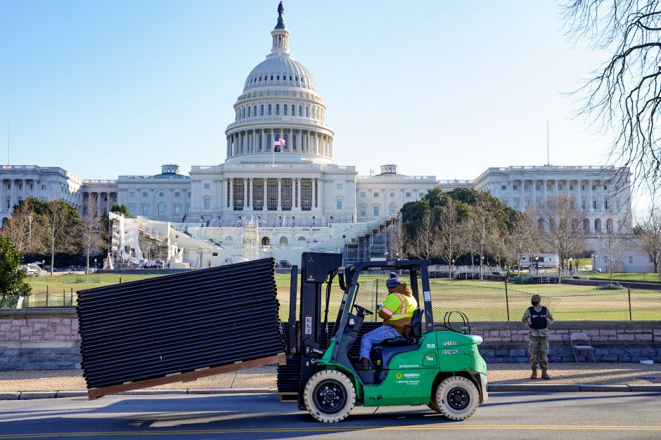 DC National Guard stands outside a mostly quiet Capitol, Thursday morning, Jan. 7, 2021 in Washington, as workers place security fencing in place. The House and Senate certified the Democrat