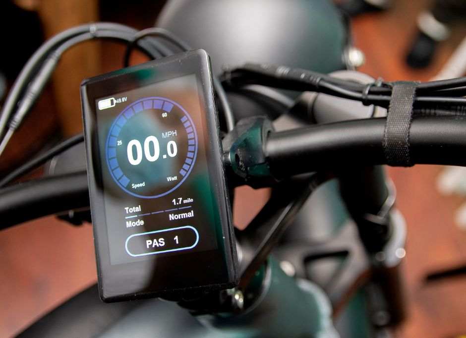 A digital display on one of the electric bikes.
