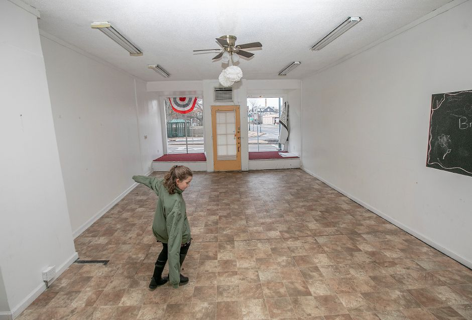 Juliana Terrace, 8, of Wallingford, plays inside a building her parents Michael and Lura purchased at 4 Center St. in Wallingford, Thurs., Dec. 26, 2019. The couple plans to fix it up and rent it out, but there are no prospective tenants yet. The building was erected in 1900 and is zoned as mixed residential and commercial use. Dave Zajac, Record-Journal