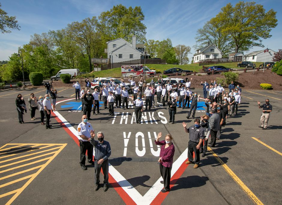 EMS staff wave from a heart after a ceremony honoring them at Hunter