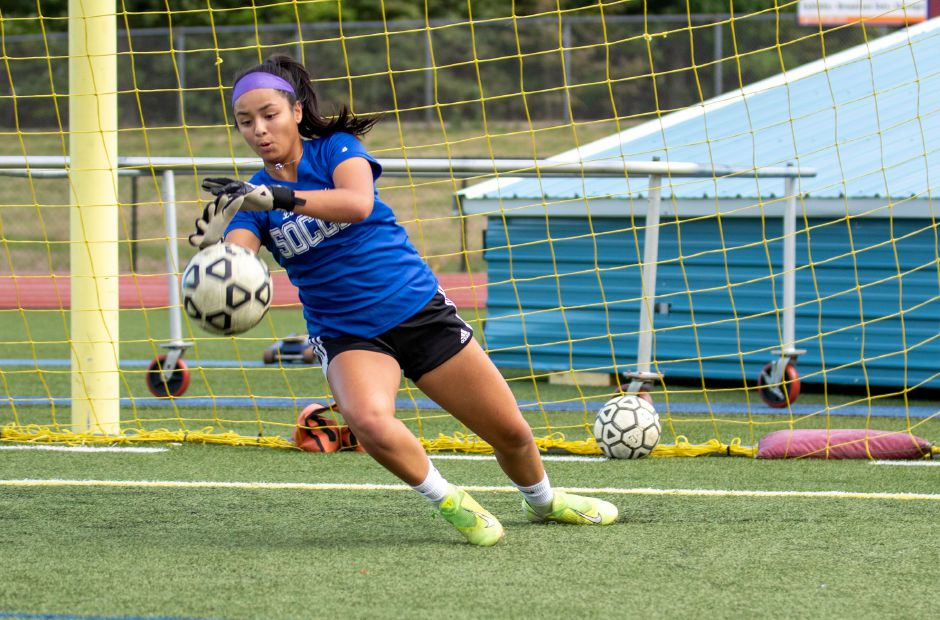 Southington senior goalie Emily Eigo works on making saves during a recent practice. Eigo, who split time in net last year for the 17-1-2 Blue Knights, is coming off a stellar performance in the Class LL title game loss to Glastonbury. Aaron Flaum, Record-Journal