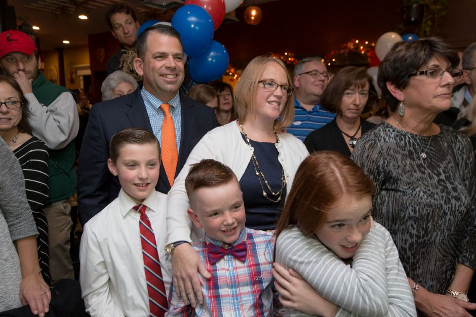 Erin Corso gives a hug to her kids Matthew 9 center and Maggie 10 with husband Joe and cousin Vincent Damico 9 left at Republican Headquarters in Gaetano