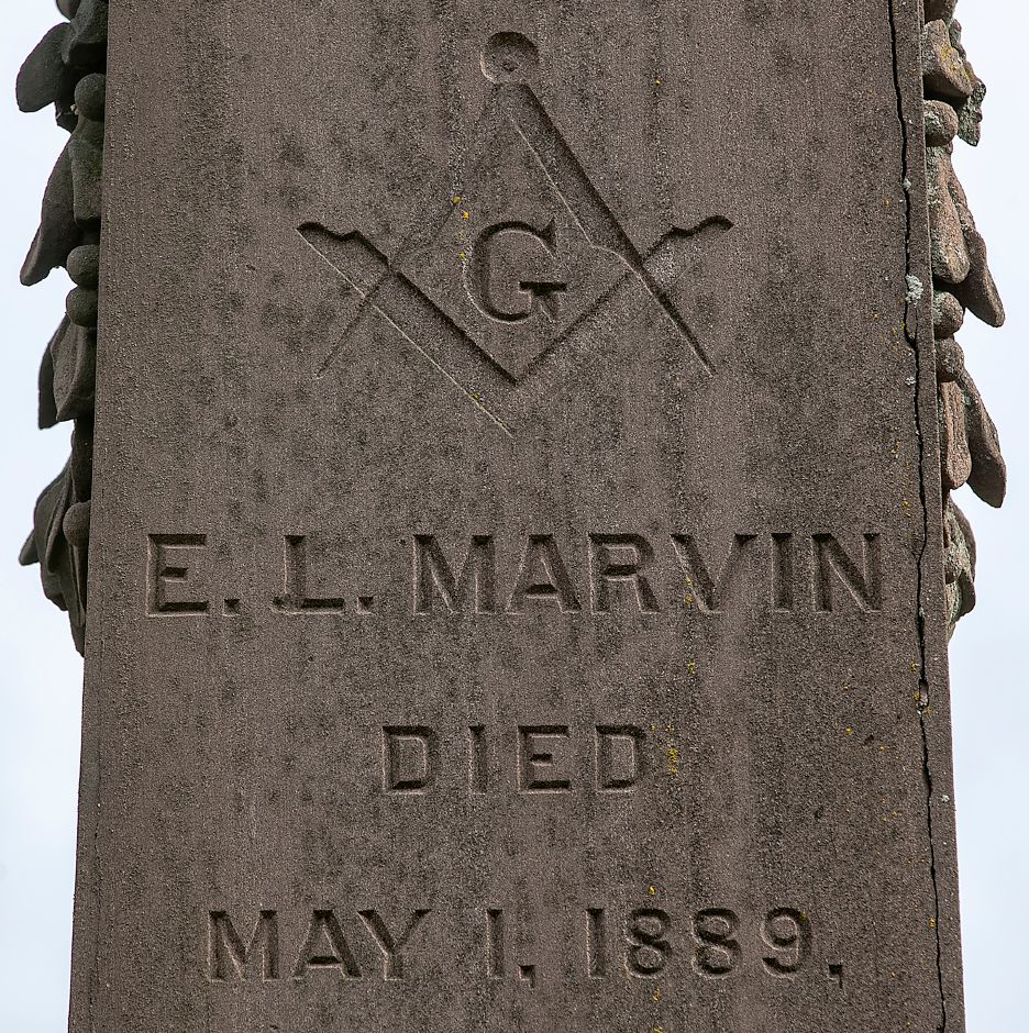 The symbol of Freemasonry engraved on the memorial of E. L Marvin at East Cemetery in Meriden, Mon., Oct. 12, 2020. Volunteers from Meriden