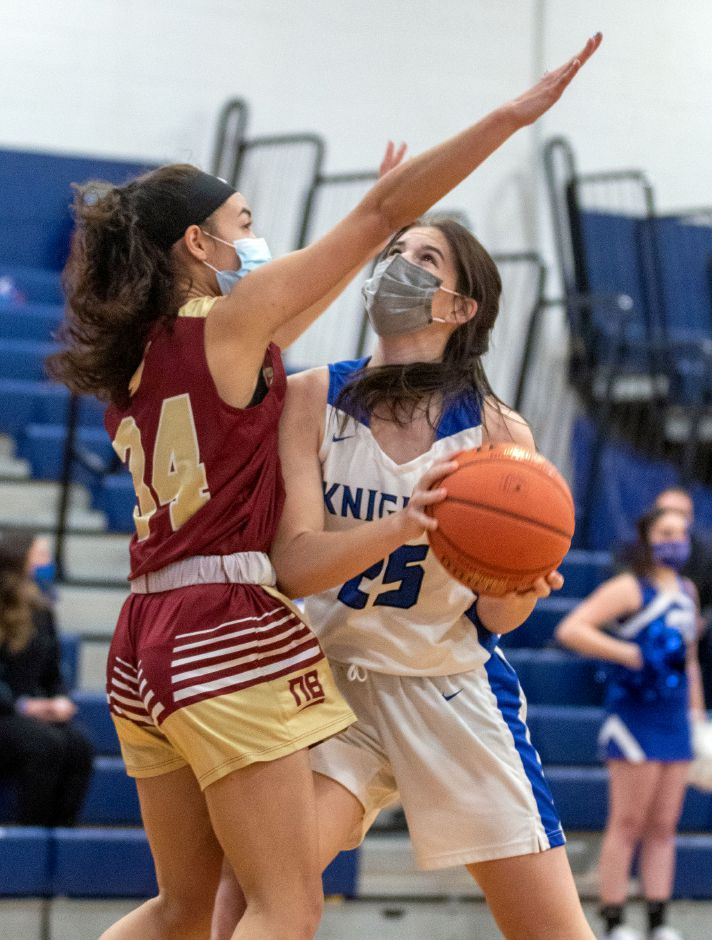 Southington's Samantha Sullivan works on getting past New Britain's Layla Mejia ass he goes for the shot during the first half at Southington High School on Wednesday, Feb. 10, 2021. Aaron Flaum, Record-Journal