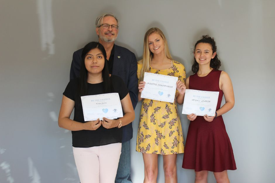 Plainville High School students Karla Juarez, Cheyenne Emmendorfer and Abigail Leander, from left, stand with Petit Family Foundation William Petit. The three students received three out of four of the foundation's Be the Change Award on Monday, June 11, 2018. | Image courtesy of the Petit Family Foundation