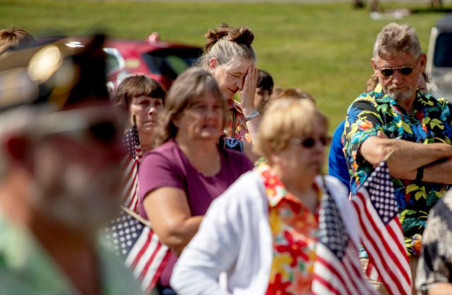 Members of the public attend a memorial service Saturday, Aug. 31, 2019, in Trumansburg, N.Y., for Sgt. James Johnston, who was killed in Afghanistan in June. Hundreds of people, some wearing Hawaiian shirts and plastic leis in Johnston
