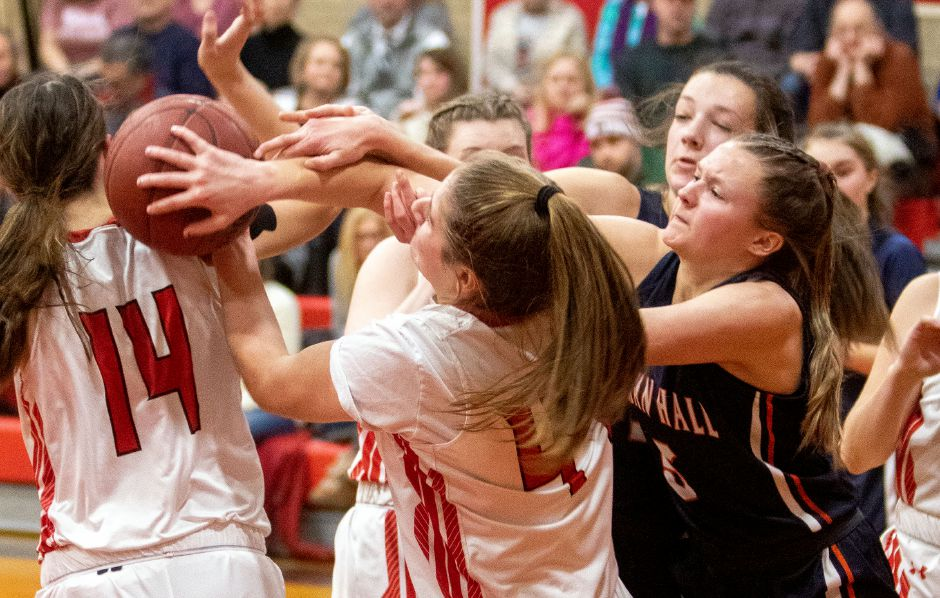 Cheshire's Rylee Post and Lyman Hall's Hailey Bruneau battle for the rebound during the first half. Photos by Aaron Flaum, Record-Journal