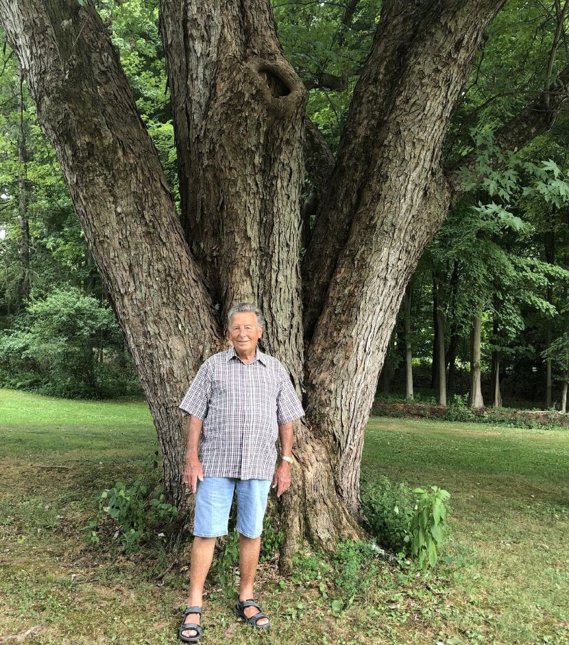 Henry Coe in front of a tree he and his wife planted when they first moved to Durham.Bronwyn Commins, For Town Times