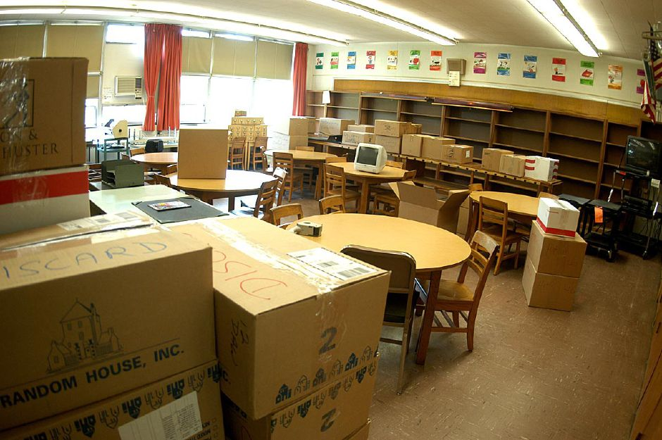 A familiar site on Friday, June 18, 2004 at North Center Elementary school as storage boxes fill each rooms the Southington school prepares to close their doors for the last time.