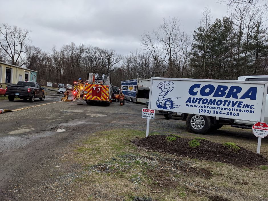 Fire crews quickly extinguished a fire in the Cobra Automotive shop at 37 Warehouse Point Road Thursday evening. Officials say damage was minimal. No injuries were reported. Michael Gagne, Record-Journal.