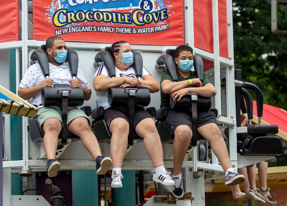 Abdul Mabrouk, left, Alex Mabrouk and Marwan Mabrouk, all cousins from Waterbury, wear  masks on the   Down Time ride.