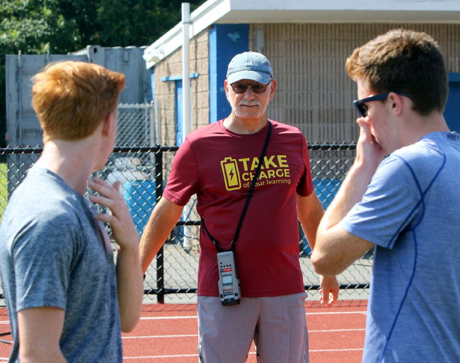 Veteran Lyman Hall cross country coach Mike Addorisio talks with his runners during a recent practice. The Trojans, like all area cross country teams, open the season on Tuesday. | Aaron Flaum, Record-Journal