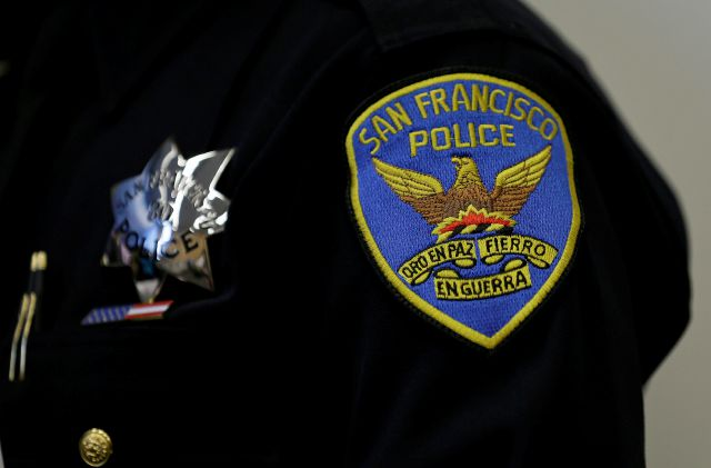 FILE -This April 29, 2016, file photo, shows a patch and badge on the uniform of a San Francisco police officer in San Francisco. The San Francisco Police Department will stop releasing mugshots of people arrested unless they pose a threat in an effort to stop perpetuating racial stereotypes, the police chief announced Wednesday, July 1, 2020. (AP Photo/Eric Risberg, File)