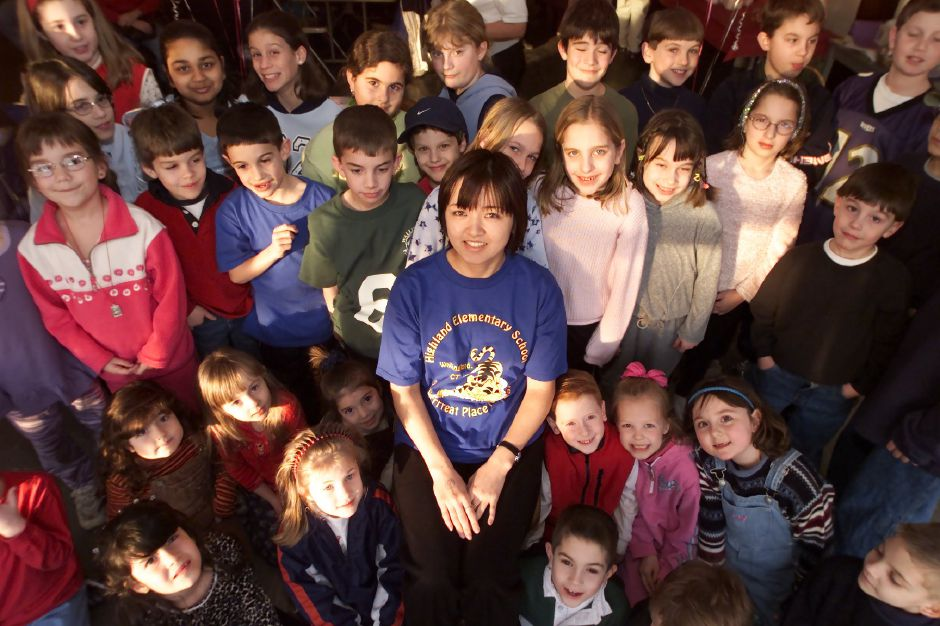 Outgoing intern Masae Yamasaki, center, with some of the students that she has taught while at Highland School in Wallingford for the past several months. A surprise party was held for her at the school Mon., Jan. 29, 2001.