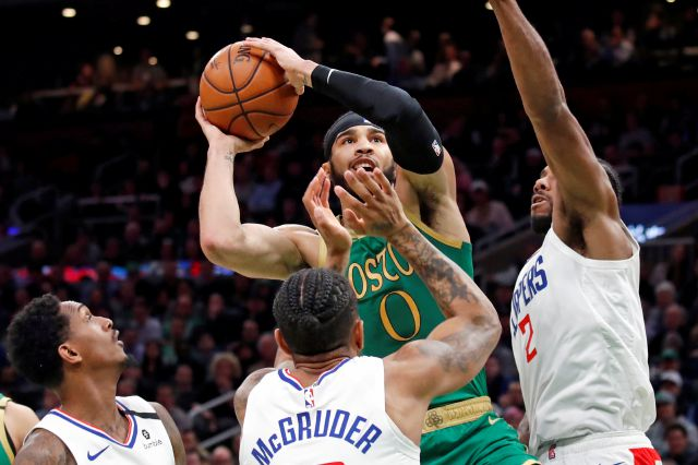 Boston Celtics forward Jayson Tatum (0) goes up to shoot against Los Angeles Clippers