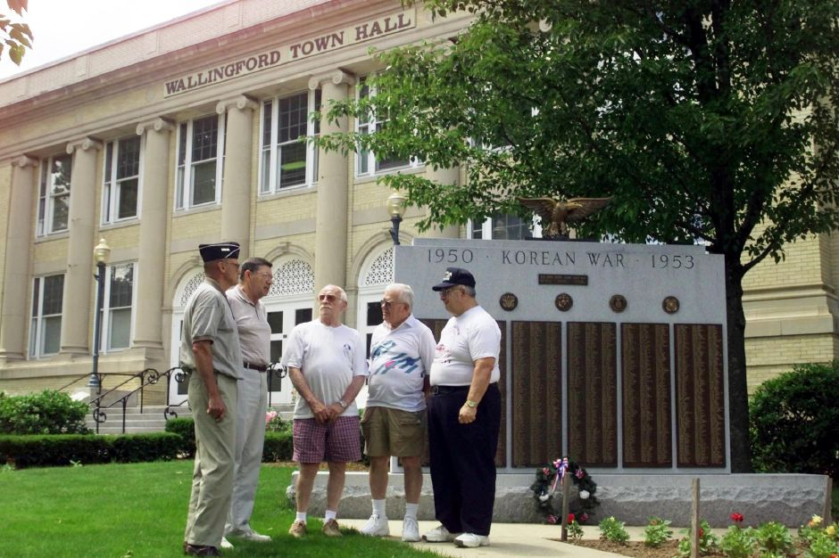 Roy Cannon, Jim Dunn, Stephen Terribile, Rod Fulton, Bob Parisi, left to right, are all Wallingford residents and veterans of the Korean War. The thirty year anniversary of the war is coming up soon. They are standing in front of the Korean War monument near the Wallingford Town Hall June 23, 2000.