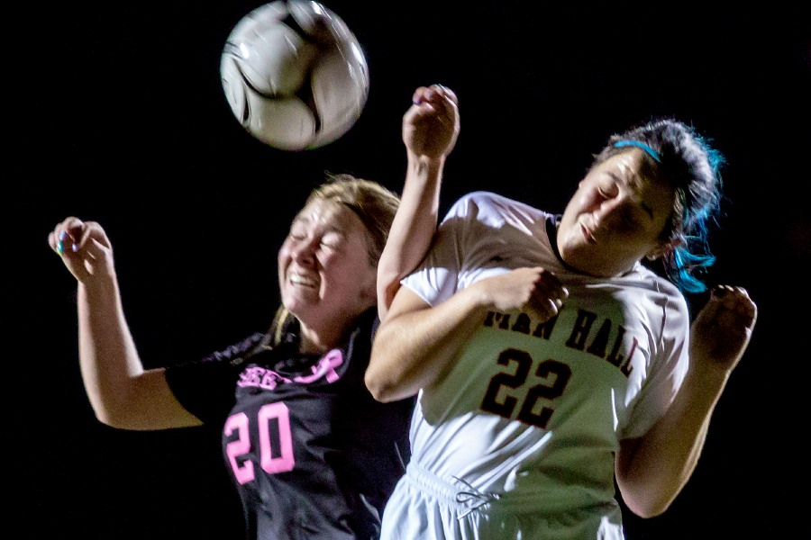 Sheehan's Dylan Smith and Lyman Hall's Sydney Raffles go for the ball during the first half at Sheehan High School on Tuesday. Smith had one of the goals in Sheehan's 4-0 victory. Aaron Flaum, Record-Journal