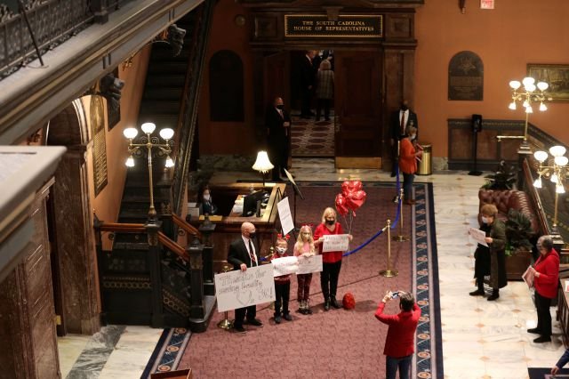Supporters of a proposal that would ban almost all abortions in South Carolina gather outside the House chamber to thank lawmakers for passing the bill on Thursday, Feb. 18, 2021, in Columbia, S.C. The governor plans to sign the bill.