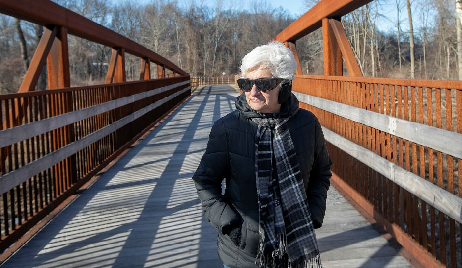 Jean Travaglini, of Wallingford, walks the Quinnipiac River Linear Trail, Tues., Feb. 26, 2019. Work on a paved recreational trail from the Wallingford Senior Center to the Community Lake area is expected to start in April. Travaglini is a member of the Wallingford Senior Center. Dave Zajac, Record-Journal