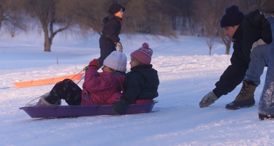 Starting down a hill on their sled are Erika Guida, 8, left, and Sarah Adamowicz, 5, getting a push by Erika
