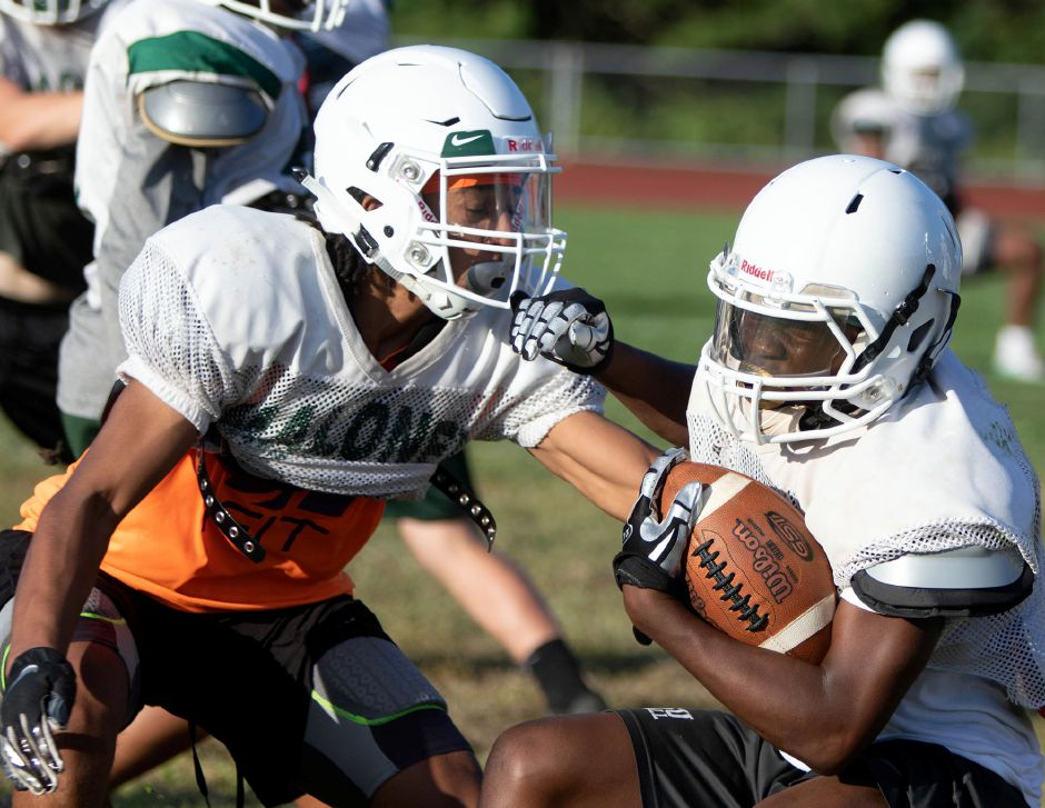 Kamron Moreno, left, stops Maloney teammate Kuron Wiggins during practice on Monday. Aaron Flaum, Record-Journal