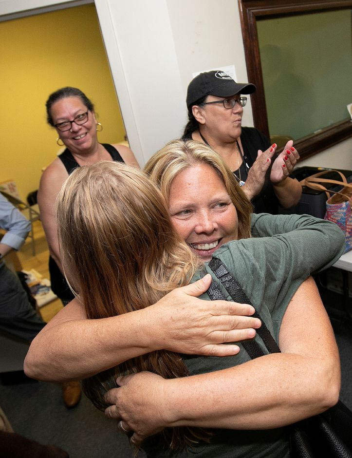Mary Daugherty Abrams hugs supporter Kahley Rowell, of California, after winning the Democratic primary for the 13th Senate seat Tuesday night Aug. 14, 2018. | Dave Zajac, Record-Journal