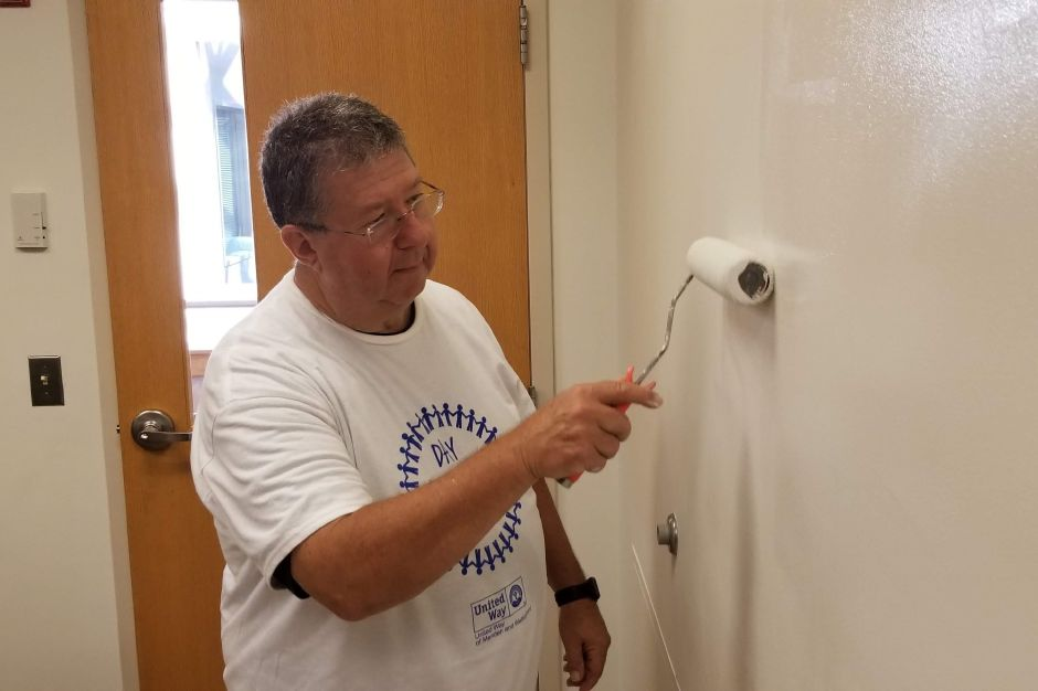 Jim Comeau, Wallingford Rotary Club, paints a wall at the Wallingford Public Library during the United Way Day of Caring Sept. 17, 2019. | Jeniece Roman, Record-Journal.