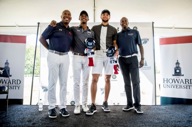 From left, Howard University Athletic Director Kery Davis, Howard student Otis Ferguson, Golden State Warriors guard Stephen Curry, and Howard University president Wayne Frederick pose for photographs together following a news conference at Langston Golf Course in Washington, Monday, Aug. 19, 2019, where Curry announced that he would be sponsoring men
