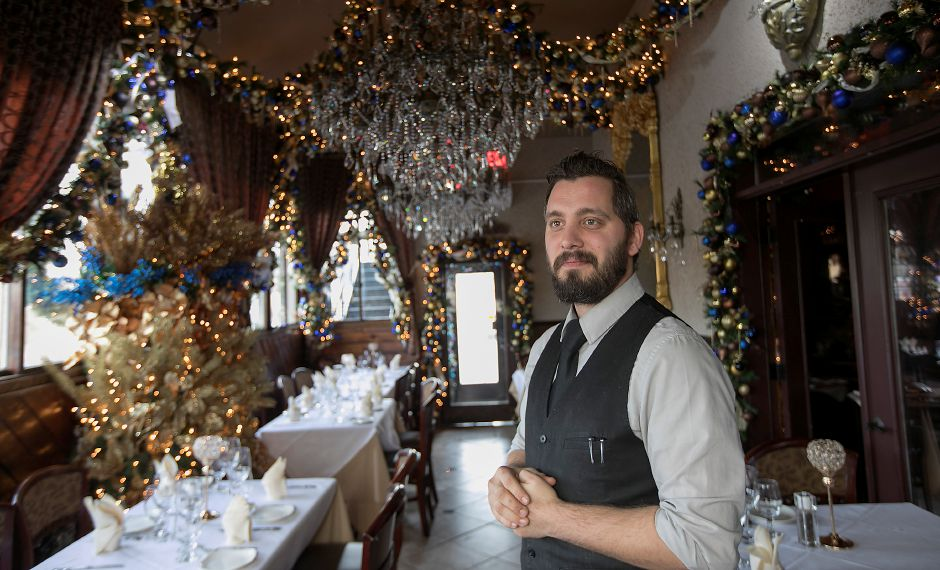 Server Julian Pappas stands in a Beauty and the Beast themed room at Cava Restaurant in Southington, Thursday, Nov. 30, 2017. Manager Tony Papahristou has designed an all new holiday display with a variety of themes this year at the West Street business. Dave Zajac, Record-Journal