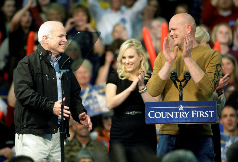 "Republican presidential candidate Sen. John McCain, R-Ariz., far left, and Samuel ""Joe The Plumber"" Wurzelbacher share the stage during a rally at Mentor High School in Mentor, Ohio, Thursday, Oct. 30, 2008. At center, McCain daughter Meghan. (AP Photo/David Guttenfelder)"