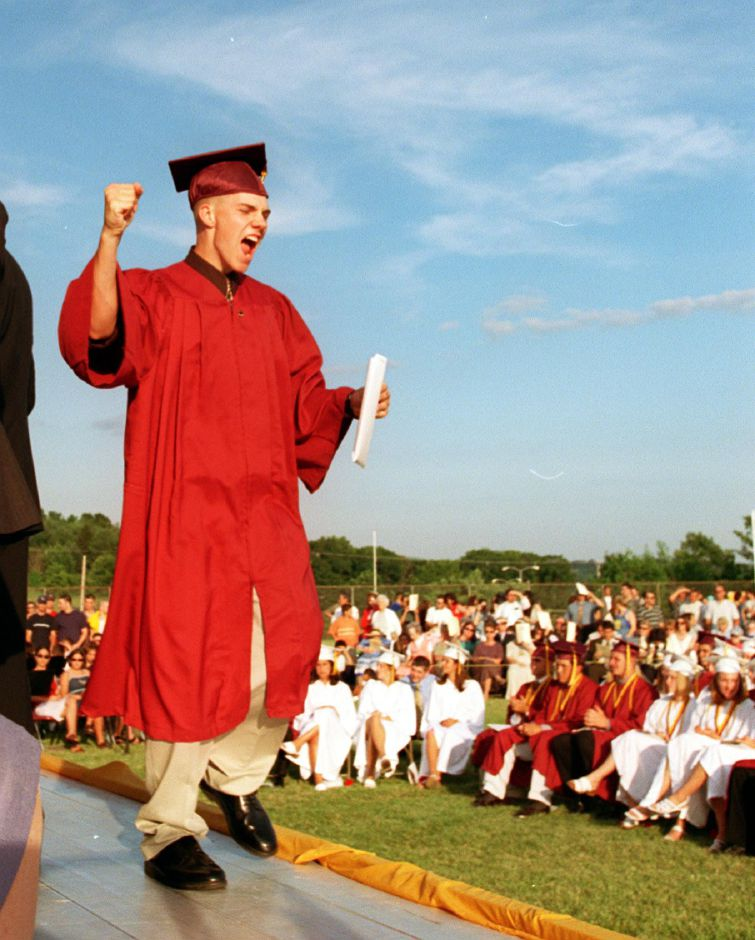 William Holland Toftness gives a cheer as he accepts his diploma at Mark T. Sheehan High School graduation Tues., June 20, 2000.