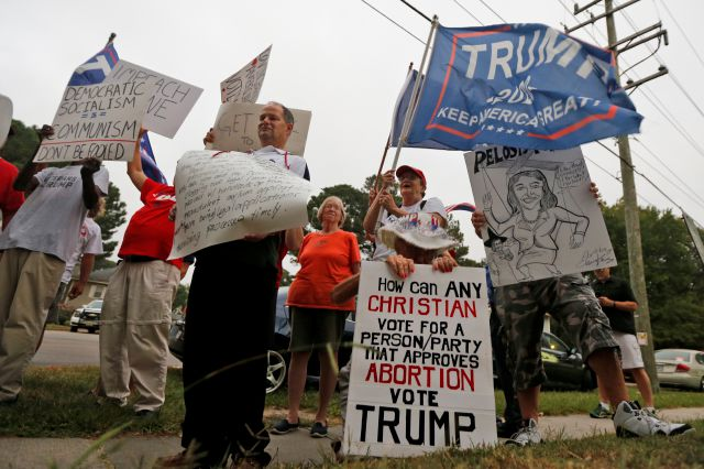 Trump supporters demonstrate outside a town hall attended by Rep. Elaine Luria, D-Va., at a church in Virginia Beach, Va., Thursday, Oct. 3, 2019. Luria recently joined a group of other Congresswomen to call for the impeachment of President Trump. (AP Photo/Steve Helber)