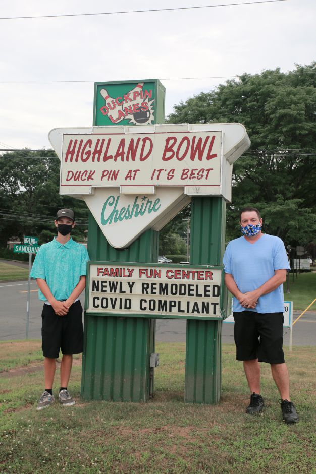 Tracey Harrington/Cheshire Herald - (From left) Ty Turcotte and the owner Todd Turcotte stand outside Highland Bowl in Cheshire.