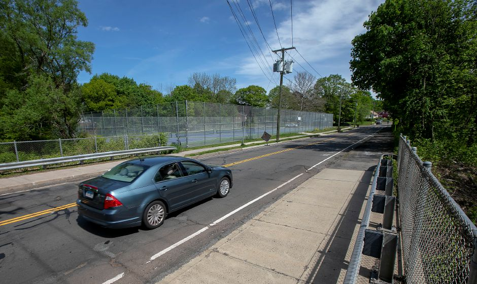 A motorist travels east on Coe Avenue near the end of the Meriden Linear Trail at Platt High School in Meriden, Tues., May 19, 2020. Dave Zajac, Record-Journal