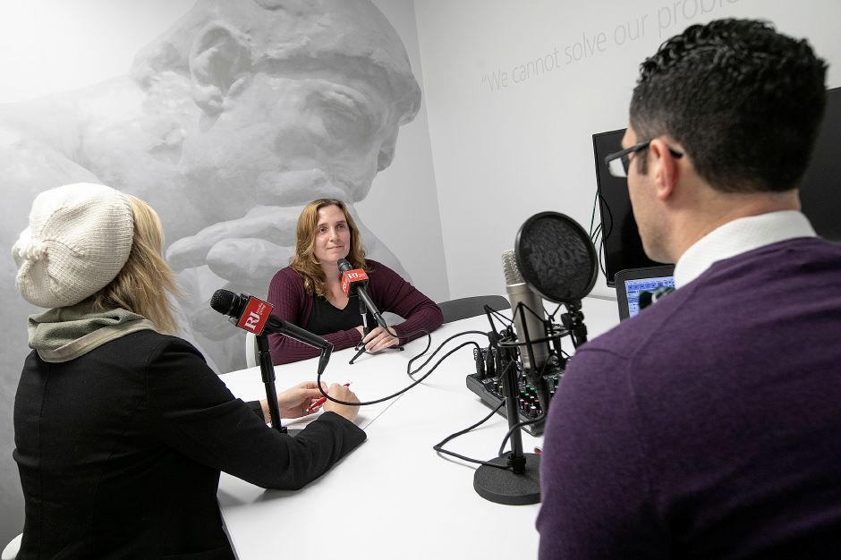 "Sarah DiMeo, center, producer of ""Faded Out,"" discusses her podcast series with reporter, Lauren Takores, left, and Local & State News Editor Mike Savino, at the Record-Journal in Meriden, Fri., Dec. 7, 2018. DiMeo"