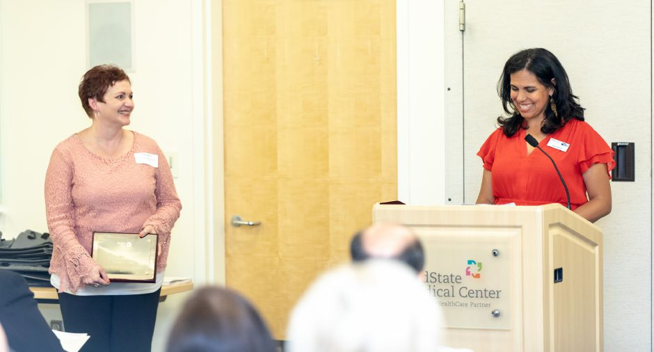 Maria Harlow, right, executive director of the United Way of Meriden and Wallingford, speaks at the nonprofit