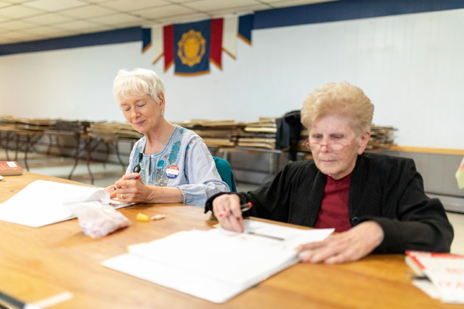 Poll workers Pat Baxa, left, and Nita Chojnicki staff the polling location at the Berlin American Legion during the April 30, 2019 budget referendum. Voters narrowly rejected the school budget as too low, while voting against the municipal budget as too high. | Devin Leith-Yessian/Berlin Citizen
