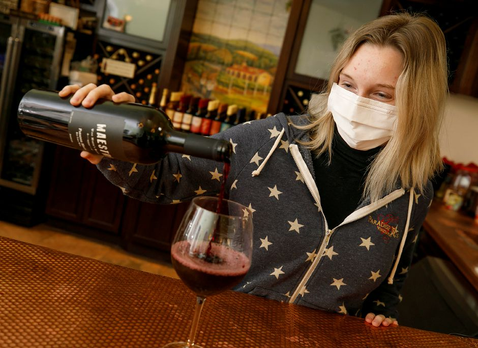 "Wine server Keeley Keating pours a glass of ""Maestro"" at Paradise Hills Vineyard & Winery in Wallingford on  Jan. 14.Dave Zajac, Record-Journal file photo"