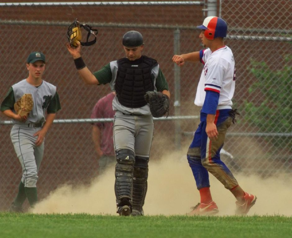 Josh is disgusted after a Southington player slides in for a run, June 1999.