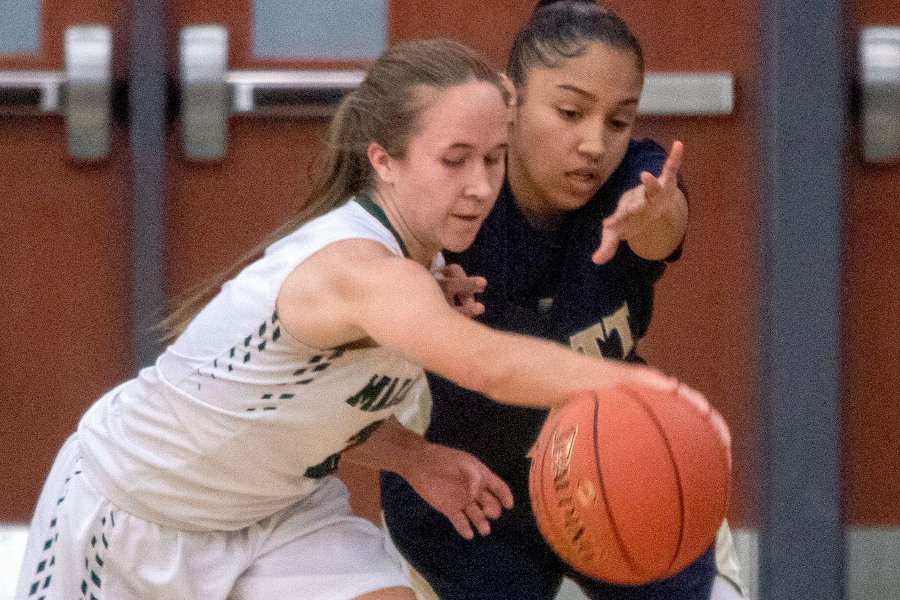 Maloney's Liv Aitken steals the ball from Platt's Kaylani Cruz during the first half of Tuesday night's rivalry game at Maloney High School.