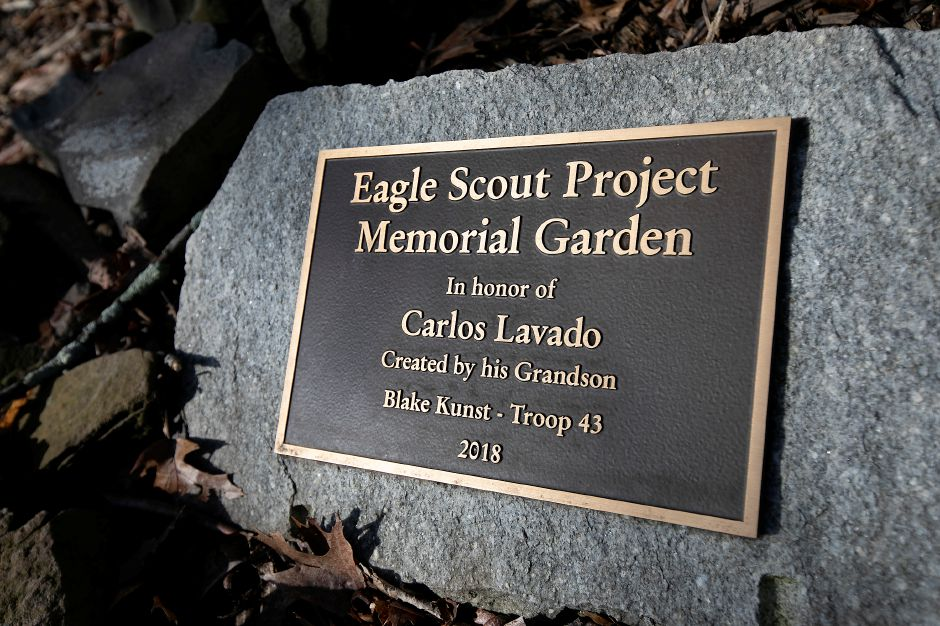 A plaque honoring Carlos Lavado, the grandfather of Blake Kunst, 19, of Meriden, who created a memorial garden for him at Hunter Golf Course in Meriden, Thurs., Feb. 27, 2020. The 19-year-old diagnosed with Autism Spectrum Disorder is a maintenance worker at the course on Westfield Road. Kunst constructed the garden as part of his Eagle Scout project in 2018. Dave Zajac, Record-Journal