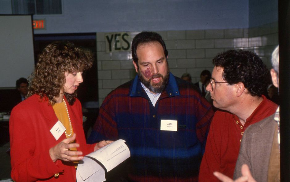 RJ file photo - Home health care specialist Michelle Evitts and John Hogarth of the Meriden Senior Center speak with Larry Susskind, center, of Endispute Inc. at a meeting at Lincoln Middle School in Meriden Jan. 13, 1994.