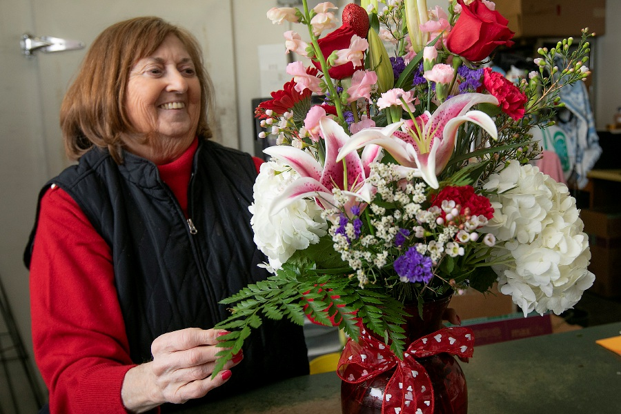 Gloria Pannone, co-owner of Shades of Green Florist, touches up a Valentine's Day floral arrangement on Wednesday inside the floral shop at 54 Chamberlain Highway in Meriden. Pannone has been busy creating dozens of arrangements for customers in preparation for Valentine's Day. Gloria and husband Fred have been running the shop for 47 years. Photos by Dave Zajac, Record-Journal