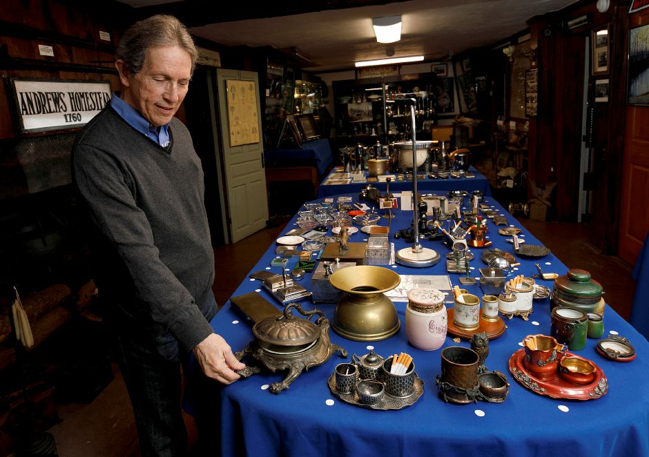 Sherwin Borsuk, president of the Meriden Historical Society, shows the workings of a turtle spittoon produced by the former Bradley & Hubbard Manufacturing Company in Meriden during the Vice in Meriden – Meriden Items for Bad Habits exhibit at the Moses Andrews Homestead, 424 W. Main St., Meriden, on Thursday. When the head of the turtle is depressed the outer shell opens. The exhibit displays products that Meriden companies produced for smoking, drinking and gambling. The exhibit will be open every Sunday in May from from 11 a.m. to 3 p.m.