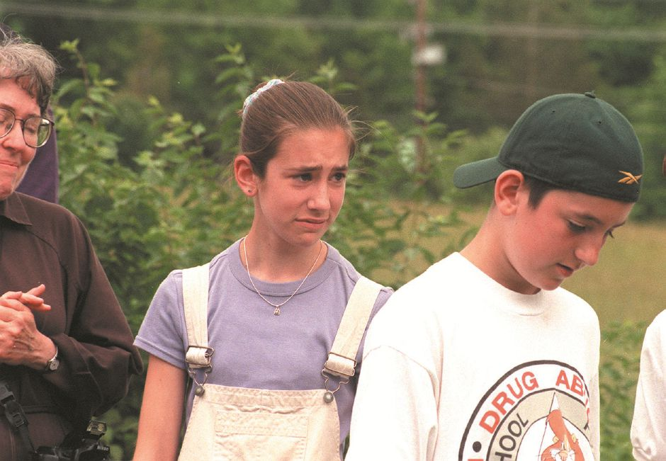 RJ file photo - From right, Eric and Sarah holding back the tears during the field dedication ceremony at the Franciscan Life Center, June 12, 1999. The playing field was dedicated in honor of their father Rick Rubelmann who was killed at the CT. Lottery Center.
